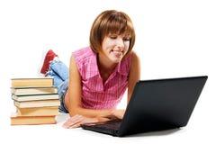 Muchacha alegre con la computadora portátil Fotos de archivo