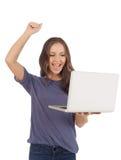 Muchacha alegre con la computadora portátil Fotografía de archivo