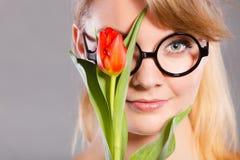 Muchacha alegre con la flor Imagenes de archivo