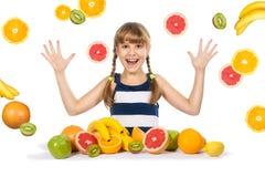Muchacha alegre con la fruta Imagen de archivo