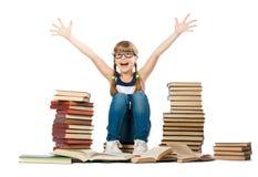 Muchacha alegre con las pilas de libros Fotos de archivo libres de regalías