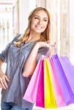 Muchacha alegre con los bolsos de compras Imagen de archivo libre de regalías