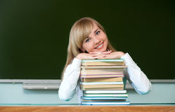 Muchacha alegre con los libros de texto Foto de archivo