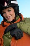 Muchacha alegre del snowboard lista para el invierno Foto de archivo libre de regalías