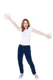 Muchacha alegre en la camiseta y los pantalones vaqueros blancos Foto de archivo libre de regalías