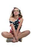 Muchacha americana divertida en el piso Foto de archivo