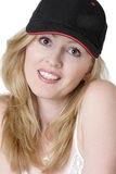 Muchacha americana en gorra de béisbol Imagen de archivo