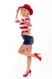 Muchacha americano-vestida atractiva Foto de archivo
