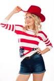 muchacha Americano-vestida en sombrero rojo Imagen de archivo