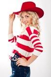 muchacha Americano-vestida en sombrero rojo Fotografía de archivo