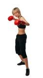 Muchacha apta en guantes de boxeo rojos Fotografía de archivo