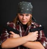 Muchacha armada del bandido Foto de archivo libre de regalías