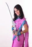 Muchacha asiática adolescente con la espada Imagen de archivo libre de regalías