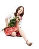 Muchacha asiática atractiva con las flores Imagen de archivo libre de regalías