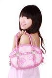 Muchacha asiática con el bolso rosado Imágenes de archivo libres de regalías