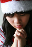 Muchacha asiática con el sombrero de Santa Foto de archivo