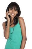 Muchacha asiática con el teléfono móvil y el auricular Imágenes de archivo libres de regalías