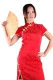 Muchacha asiática con el ventilador Imagenes de archivo