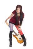 Muchacha asiática con la guitarra eléctrica Foto de archivo libre de regalías