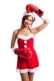 Muchacha asiática de la Navidad con la ropa de Santa Claus y el guante de boxeo Foto de archivo libre de regalías