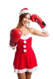Muchacha asiática de la Navidad con la ropa de Santa Claus y el guante de boxeo Imágenes de archivo libres de regalías