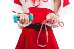 Muchacha asiática de Santa Claus de la Navidad con la cinta métrica y el dumbbel Fotografía de archivo libre de regalías