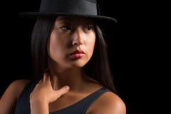 Muchacha asiática elegante en sombrero Foto de archivo libre de regalías