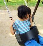 Muchacha asiática en el oscilación Fotos de archivo libres de regalías