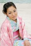 Muchacha asiática en un Komona Fotografía de archivo