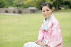 Muchacha asiática en un Komona Imagen de archivo libre de regalías