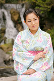Muchacha asiática en un Komona Imágenes de archivo libres de regalías