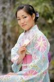 Muchacha asiática en un Komona Fotografía de archivo libre de regalías