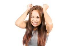 Muchacha asiática enfadada enojada que cierra de golpe rabieta de los puños Imagenes de archivo