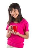 Muchacha asiática joven con la taza roja III Imagen de archivo libre de regalías