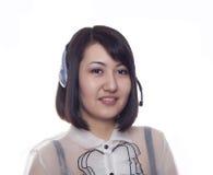 Muchacha asiática joven con un receptor de cabeza, Kazakh fotografía de archivo