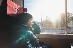 Muchacha asiática linda en el tren Fotografía de archivo