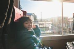 Muchacha asiática linda en el tren Fotos de archivo