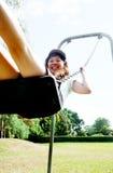 Muchacha asiática linda en un oscilación Fotografía de archivo libre de regalías