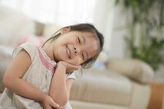 Muchacha asiática sonriente imagen de archivo