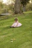 Muchacha Asiático-caucásica el 1/2 año bastante 3 en vestido rosado Imágenes de archivo libres de regalías