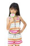Muchacha asiática con el lollipop Foto de archivo libre de regalías