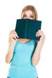Muchacha asustada con un libro Imagenes de archivo