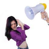 Muchacha asustada regañada con un megáfono Imagen de archivo