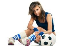 Muchacha atractiva con el balón de fútbol Imágenes de archivo libres de regalías