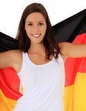 Muchacha atractiva con el indicador alemán Fotografía de archivo