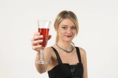 Muchacha atractiva con el vino Imagen de archivo libre de regalías