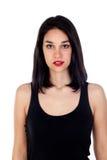 Muchacha atractiva con la camiseta negra Foto de archivo libre de regalías