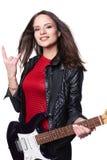 Muchacha atractiva con la guitarra eléctrica contra blanco Foto de archivo