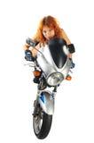 Muchacha atractiva con la motocicleta Fotos de archivo libres de regalías
