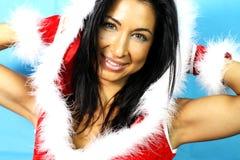 Muchacha atractiva con la ropa de Papá Noel Imágenes de archivo libres de regalías